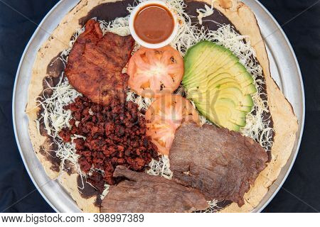 Overhead View Of Sampler Taco Plate To Share With Family Including Carne Asada Steak, Hamburger, Pol