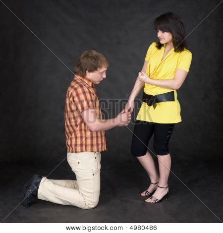 Man Is Kneeling To The Young Woman, Being Sorry