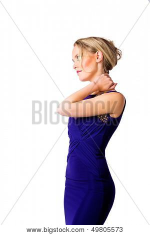 young beautiful woman with upstyle blond hair wearing tight blue evening dress with on her fit slim body over white studio background. Hand on her neck