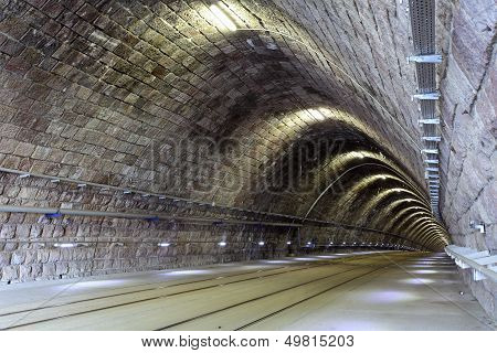 Tunnel in a night with railroad lines poster