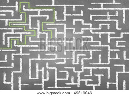 poster of Drawn abstract maze against white background. Finding solution