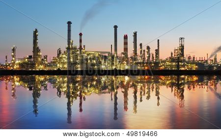 Oil and gas refinery at twilight with reflection - factory - petrochemical plant poster