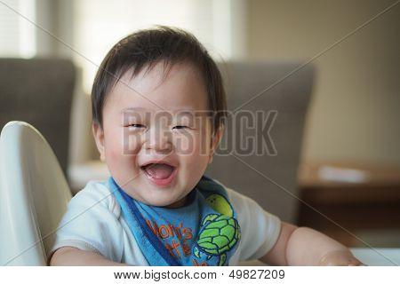 Baby boy on high chair