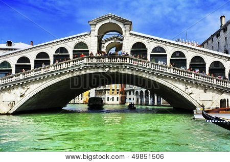 VENICE, ITALY - APRIL 11: A view of the Grand Canal and the Rialto Bridge on April 11, 2013 in Venice, Italy. This main canal is 3800 meter long, 30-90 meters wide, with an average depth of 5 meters