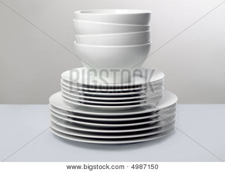 Commercial White Dishes With Monochromatic Background