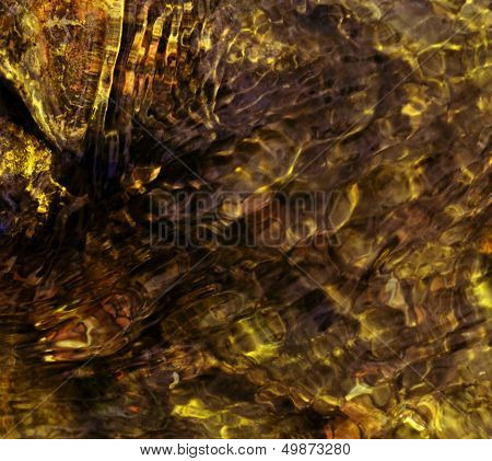 background of yellow colored ripples on water stream poster