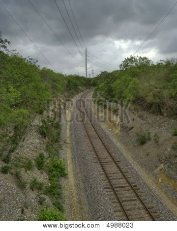 Hdr Railroad Tracks Against Cloudy Sky