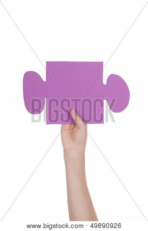 Hand Holding A Piece Of A Puzzle