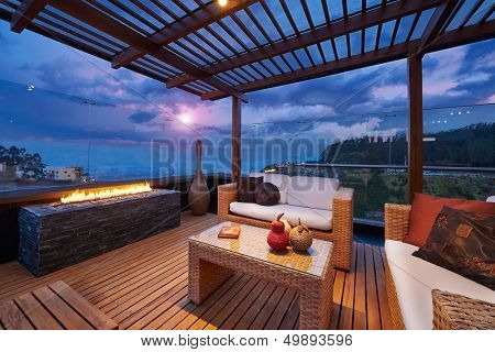 Interior design: Beautiful modern terrace lounge with pergola at sunset