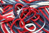 Background of the colorful knitted yarn close up poster
