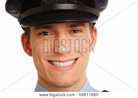 Portrait of smiling young policeman close up