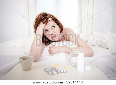 Red Haired Girl With Hangover Wanting Coffee In Bed