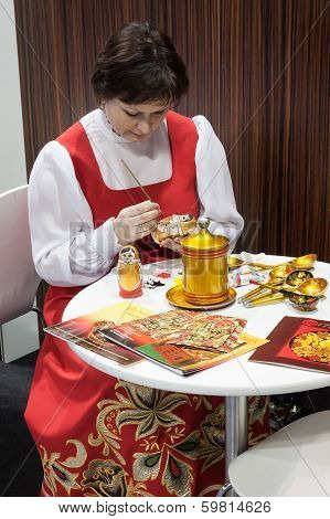 Russian Woman Painting A Matryoshka At Bit 2014, International Tourism Exchange In Milan, Italy