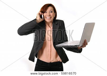 Happy Business Woman With Red Hair Talking On The Mobile Cell Phone Holding Laptop