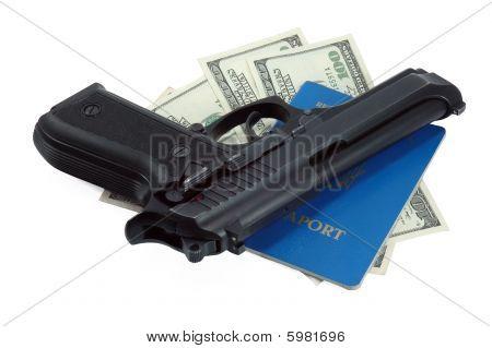 Black gun,  bullets and cash