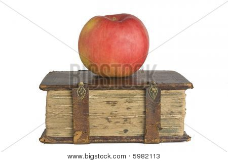 Old book and apple