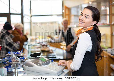 Salesperson At Cash Register