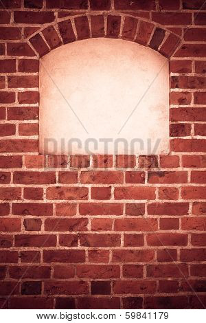 Old stone arch arc niche with space for text frame in brick wall background poster