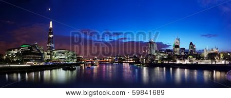 London skyline panorama at night, England the UK. Tower of London, The Shard, City Hall, River Thames as seen from Tower Bridge poster