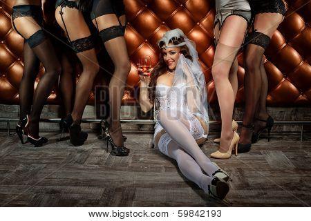 Beautiful women in retro underwear next to bar counter