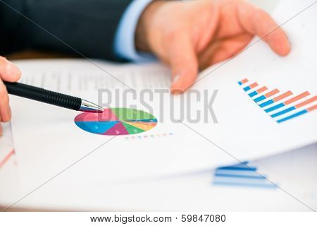 Business - banker, Manager or expert evaluates the figures on and compares the development of the business in real time to quickly and efficient advise and act as consultant
