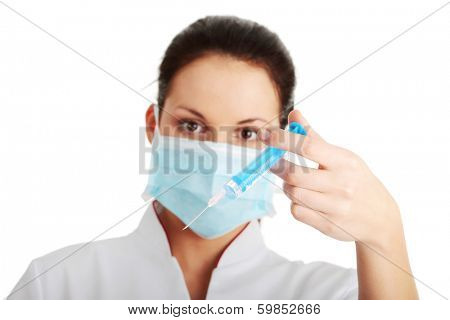 Young nurse in mask with syringe, isolated on white background