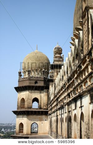 A view of the beautiful architeture of the artistically carved towers of the Gol Gumaz in Bijapur India. The dome happens to be the 2nd largest constructed dome in the world. poster