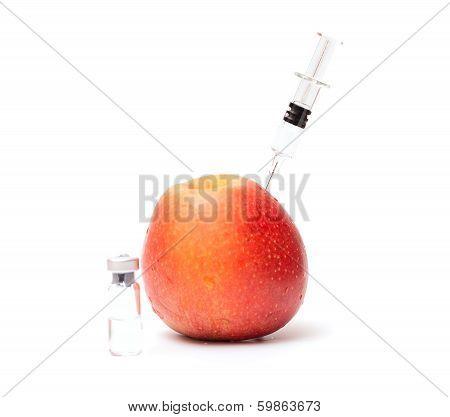 Syringe In Apple And Bottle