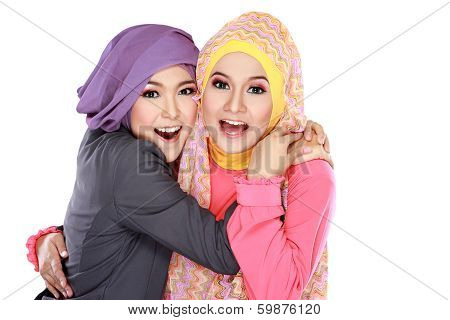 Two Beautiful Moslem Woman Having Fun Together