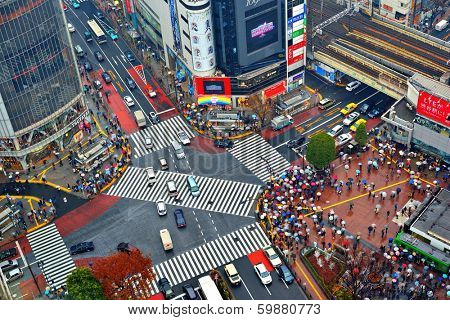 TOKYO, JAPAN - DECEMBER 15, 2012:  Traffic passes through Shibuya Crossing. The intersection is considered one of the world's busiest scramble crosswalks.
