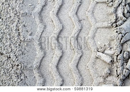 Closeup of tire tracks in sand