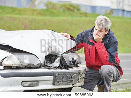 Adult upset driver man inspecting automobile body after crash car collision accident poster