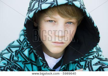 Boy In Hood Looking To Camera