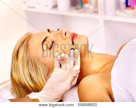 Doctor woman giving injections. Isolated.