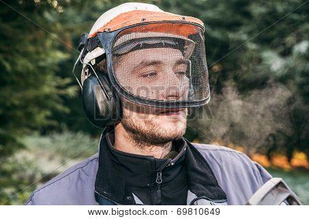 Professional Gardener In Helmet