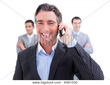 Laughing Businessman Talking On Phone