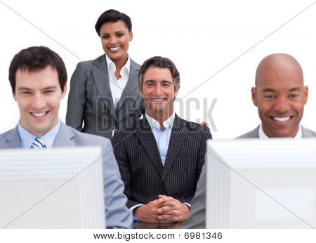 Cheerful Business People Working At Computers