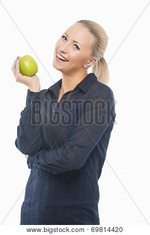 Dental Health Concept: Causasian Blond Female With Green Apple In Front Of Her Mouth