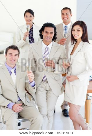 Successful Business Team Drinking Champagne