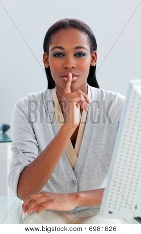 Charming Businesswoman Asking For Silence At Her Desk