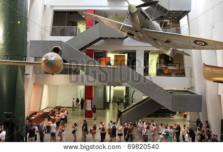 LONDON - AUGUST 1: Visitors viewing exhibits in the atrium of the newly refurbished Imperial War Museum on August 1, 2014 in London, UK