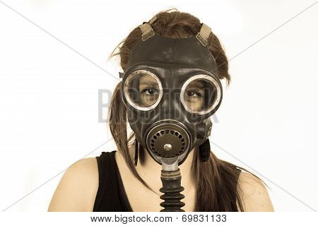 Young girl wearing gas mask