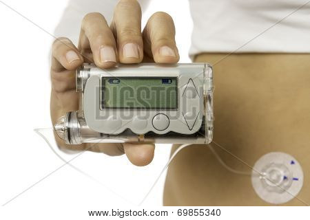 detail of a hand holding an insuline pump isolated on a white background - focus on insuline pump poster