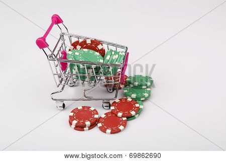 Shopping Cart With Casino Chips Over White