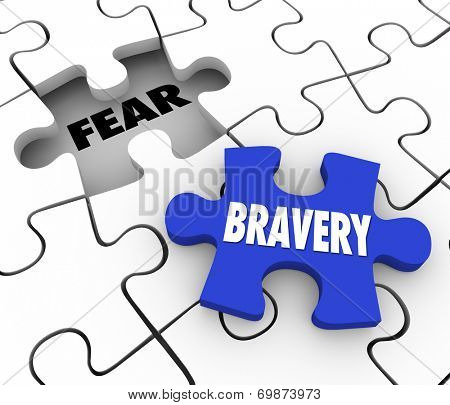Bravery word on a puzzle piece about to fill the word Fear conquering adversity and being bold and courageous to overcome a challenge