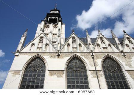 Brussels Belgium. Church in district Marolles (Marollen). Notre Dame de la Chapelle (Kapellekerk). Romanesque-Gothic style. Famous painter Peter Bruegel the Elder is buried here. poster