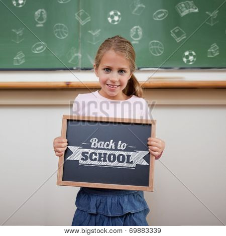 Back to school message against cute pupil showing chalkboard poster
