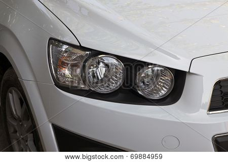 the right headlight of a car