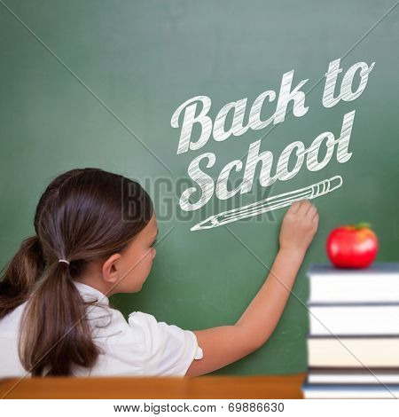 Back to school message against cute pupil writing on chalkboard poster