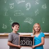 Back to school message against cute pupils showing chalkboard poster